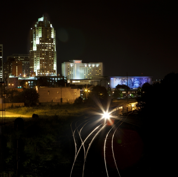 Raleigh at night with train